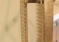 Custom fabricated, milled, gilded shower door pull.
