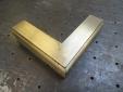 Brass corner for shower doors.