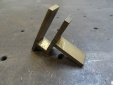 Fabricated bronze clip for wall sconces.