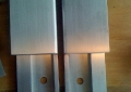 Custom fabricated stainless steel door pulls.