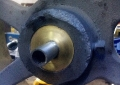 Custom brass and stainless axle for wheel.