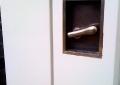 Custom cast and milled black nickel door pull.